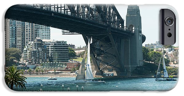 Sailboats iPhone Cases - Sailboat Passing Under The Sydney iPhone Case by Panoramic Images