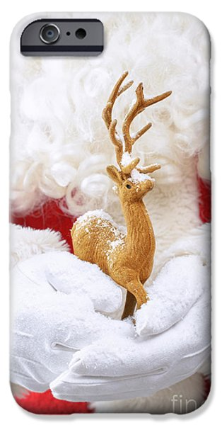 Father Christmas iPhone Cases - Santa Holding Reindeer Figure iPhone Case by Amanda And Christopher Elwell