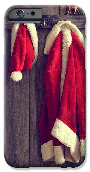 Ledge iPhone Cases - Santas Hat And Coat iPhone Case by Amanda And Christopher Elwell