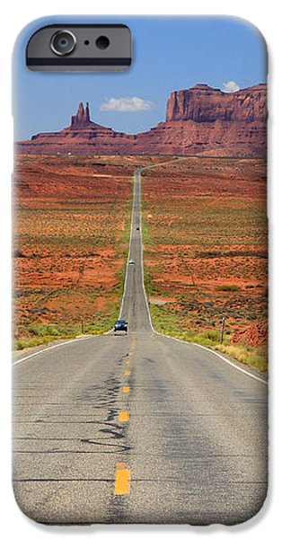 Scenic road into Monument Valley iPhone Case by Johnny Adolphson