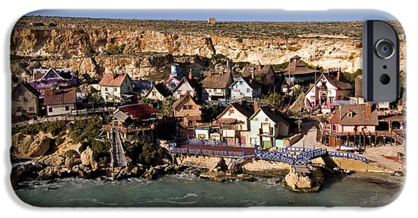 Clapboard House iPhone Cases - Seaside Village Under The Cliffs iPhone Case by Tim Holt