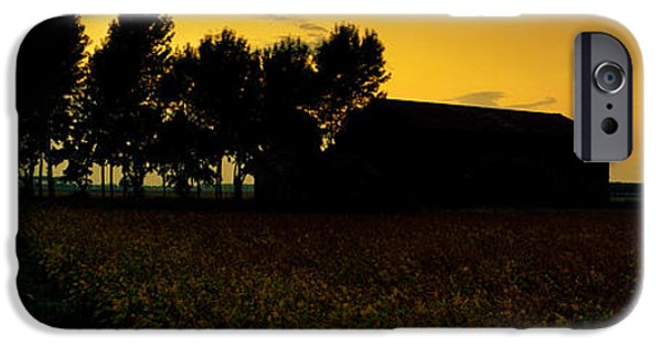 Field. Cloud iPhone Cases - Silhouette Of A Farmhouse At Sunset iPhone Case by Panoramic Images