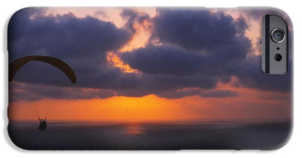 Getting Away From It All iPhone Cases - Silhouette Of A Person Paragliding iPhone Case by Panoramic Images
