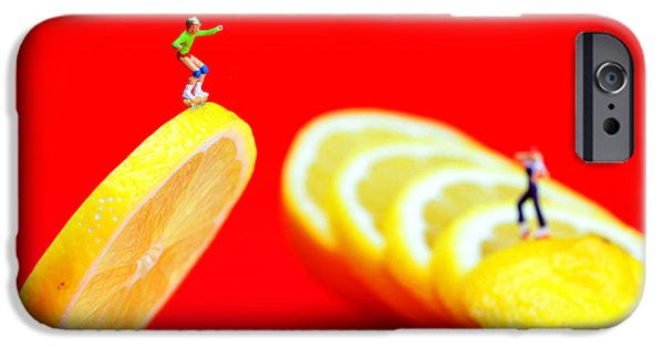 Young Digital iPhone Cases - Skateboard rolling on a floating lemon slice iPhone Case by Paul Ge