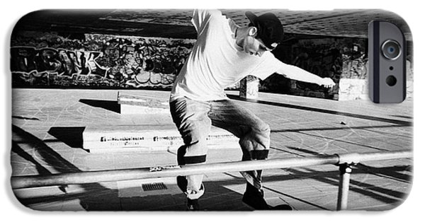Skateboards iPhone Cases - skateboarder at the undercroft skate park of the southbank centre London England UK iPhone Case by Joe Fox