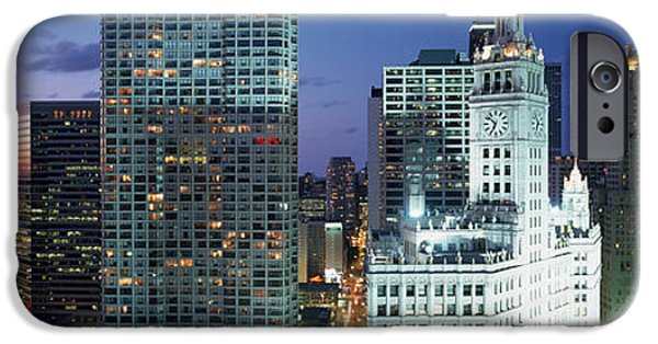 Sears Tower iPhone Cases - Skyscraper Lit Up At Night In A City iPhone Case by Panoramic Images