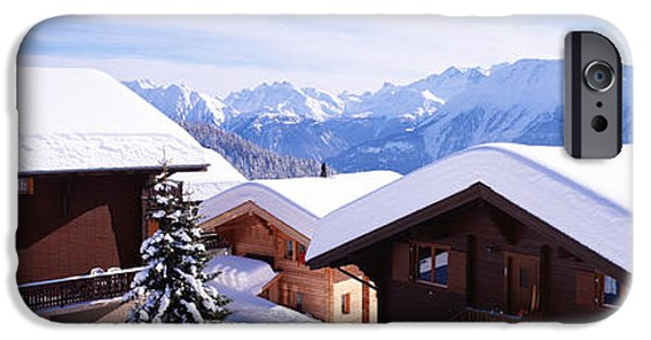 Snow-covered Landscape Photographs iPhone Cases - Snow Covered Chapel And Chalets Swiss iPhone Case by Panoramic Images