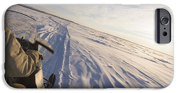 Drifting Snow Photographs iPhone Cases - Snowmachiner Following Trail On Frozen iPhone Case by Kevin Smith