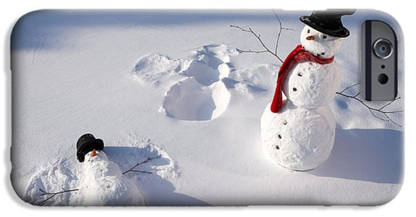 Snowbank iPhone Cases - Snowmen In Forest Making Snow Angel iPhone Case by Kevin Smith