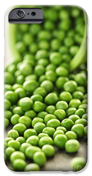 Pouring iPhone Cases - Spilled bowl of green peas iPhone Case by Elena Elisseeva