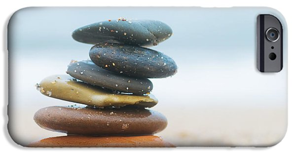 Stone Buildings iPhone Cases - Stack of beach stones on sand iPhone Case by Michal Bednarek
