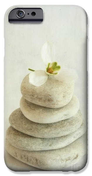 Piles iPhone Cases - Stacked stones with a snowdrop iPhone Case by Priska Wettstein
