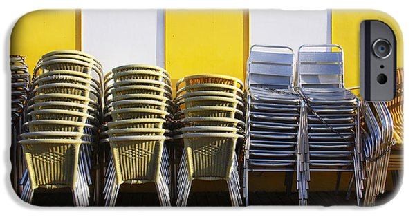 Aluminum iPhone Cases - Stacks of Chairs and Tables iPhone Case by Carlos Caetano