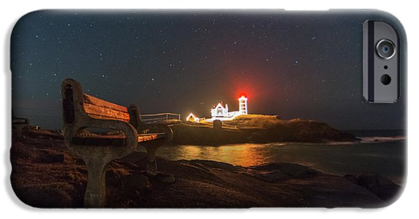 Nubble Lighthouse iPhone Cases - Starry skies over Nubble Lighthouse  iPhone Case by Bryan Xavier