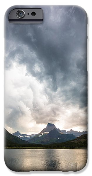 Canoe iPhone Cases - Storm over Swiftcurrent Lake iPhone Case by Inge Johnsson