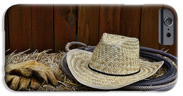 Working Cowboy Photographs iPhone Cases - Straw Hat  on  Hay iPhone Case by Paul Ward