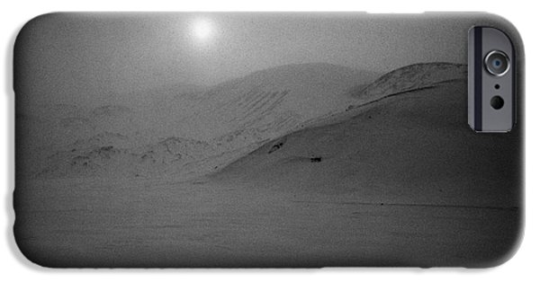 Harsh Conditions iPhone Cases - sun breaking through white out snowstorm whalers bay deception island Antarctica iPhone Case by Joe Fox