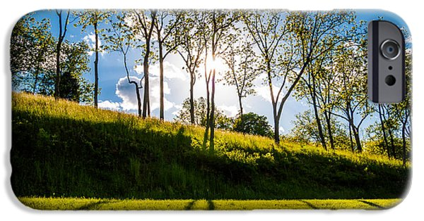 Organic Pastels iPhone Cases - Sun shining through trees and shadows on the grass at Antietam National Battlefield Maryland iPhone Case by Jon Bilous