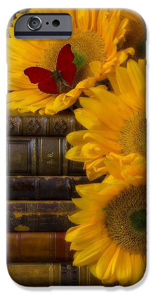 Pile iPhone Cases - Sunflowers and old books iPhone Case by Garry Gay