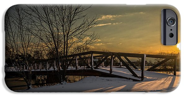 Wintertime iPhone Cases - Sunrise over a snow covered bridge iPhone Case by Chris Bordeleau