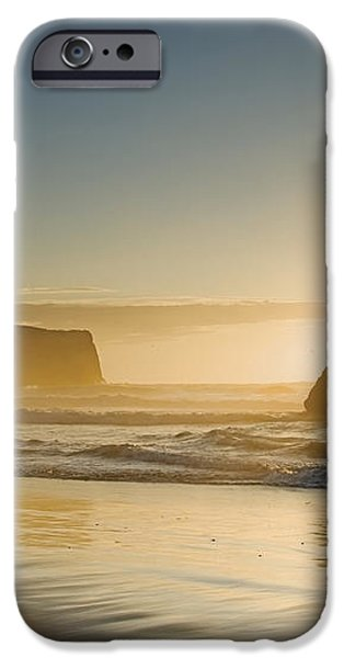 Sunset Behind Offshore Rocks Bandon iPhone Case by Philippe Widling