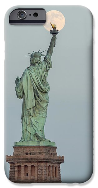 Moonscape iPhone Cases - Super Moon Rises Over The Statue Of Liberty iPhone Case by Susan Candelario