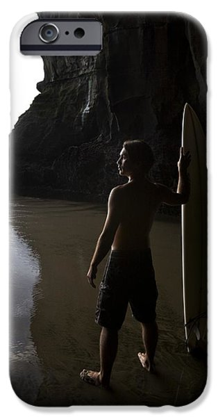 Water In Caves iPhone Cases - Surfer At Muriwai New Zealand iPhone Case by Deddeda