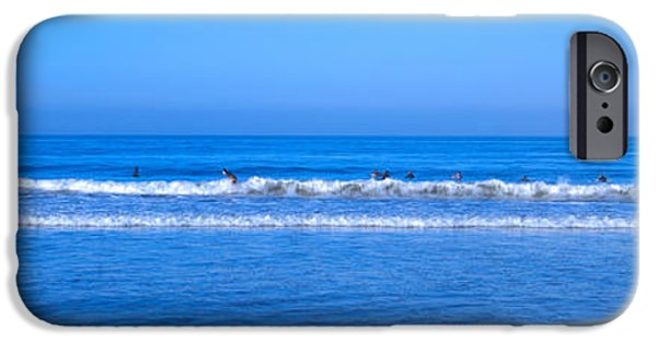Santa iPhone Cases - Surfers Riding A Wave In The Sea, Santa iPhone Case by Panoramic Images