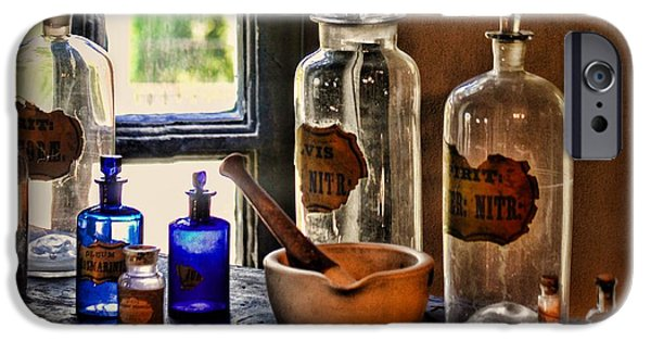 Old Grinders iPhone Cases - The Pharmacy Shelf iPhone Case by Paul Ward