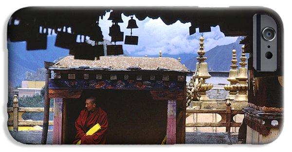 Tibetan Buddhism iPhone Cases - Tibetan Monk with Scroll on Jokhang Roof iPhone Case by Anna Lisa Yoder