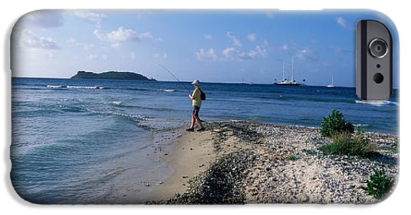 Getting Away From It All iPhone Cases - Tourist Fishing On The Beach, Sandy iPhone Case by Panoramic Images