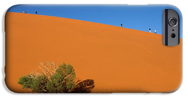 Sand Dunes iPhone Cases - Tourists Climbing Up A Sand Dune, Dune iPhone Case by Panoramic Images