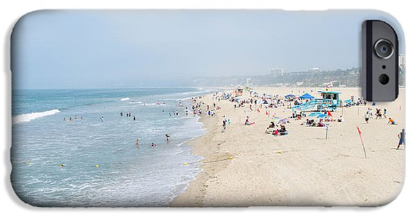 Santa iPhone Cases - Tourists On The Beach, Santa Monica iPhone Case by Panoramic Images