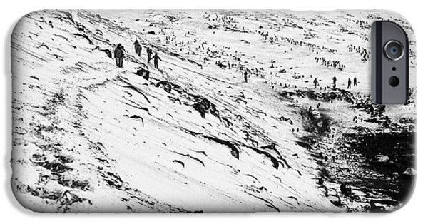 Shore Excursion iPhone Cases - tourists walking along ridge at hannah point penguin colony Antarctica iPhone Case by Joe Fox