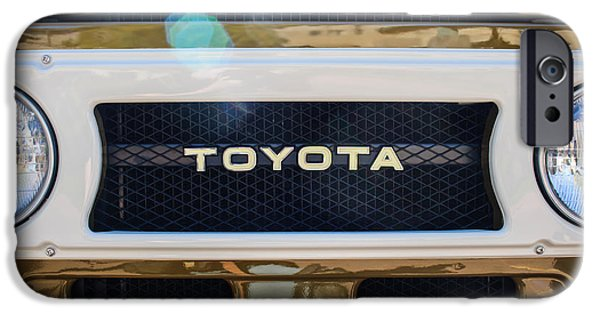 Classic Car Pictures iPhone Cases - Toyota Land Cruiser Grille Emblem  iPhone Case by Jill Reger