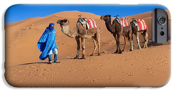 Camel Photographs iPhone Cases - Tuareg Man Leading Camel Train iPhone Case by Panoramic Images