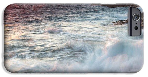 Turbulent Skies iPhone Cases - Turbulent sea under a fiery orange sunset iPhone Case by Nikos Vlasiadis
