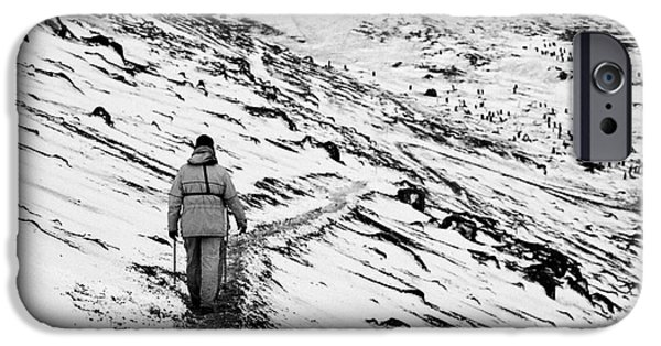 Shore Excursion iPhone Cases - two tourists walking along ridge at hannah point penguin colony Antarctica iPhone Case by Joe Fox