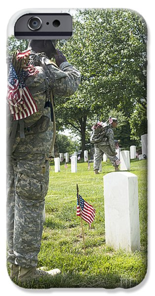 Headstones iPhone Cases - U.s. Army Soldiers Place Flags In Front iPhone Case by Stocktrek Images
