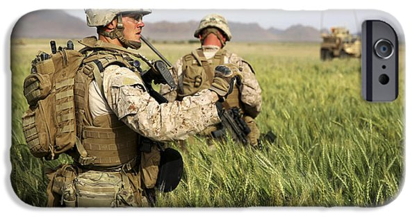 East Village iPhone Cases - U.s. Marines Patrol Through A Field iPhone Case by Stocktrek Images