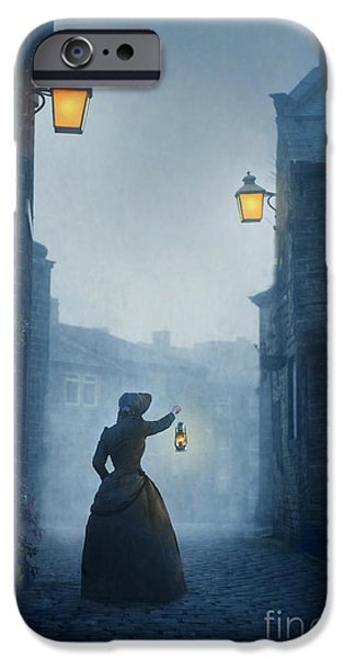 Creepy iPhone Cases - Victorian Woman With An Oil Lamp At Night On A Cobbled Street iPhone Case by Lee Avison