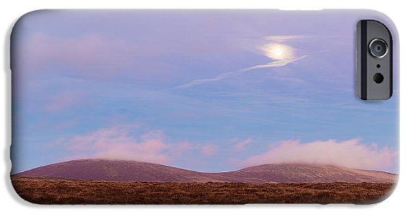 Turbulent Skies iPhone Cases - View of War Hill and Djouce Mountain at moonrise iPhone Case by Semmick Photo