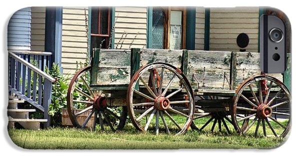 Wooden Wagons iPhone Cases - Wagon Wheels In Dodge City iPhone Case by Dan Sproul