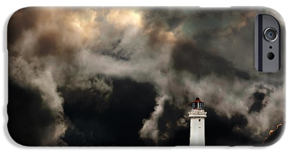 Turbulent Skies iPhone Cases - White lighthouse with dramatic storm clouds iPhone Case by Ken Biggs