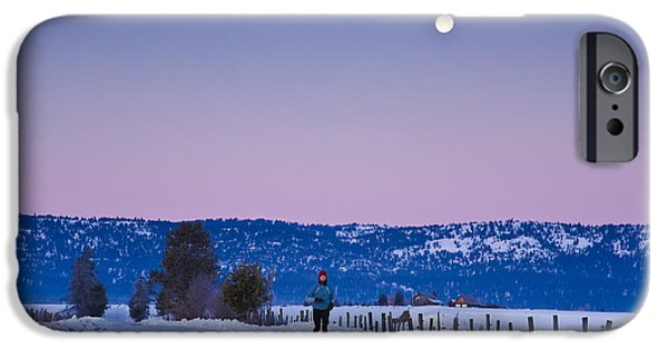 Moonscape iPhone Cases - Woman Jogging In Winter On Rural Road iPhone Case by Michael DeYoung