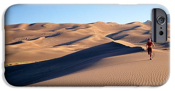 Jogging iPhone Cases - Woman Running In The Desert, Great Sand iPhone Case by Panoramic Images