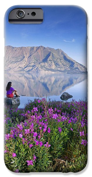 Women Together iPhone Cases - Woman Sitting On Rock Views Kluane Lake iPhone Case by Michael DeYoung