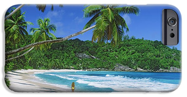 Getting Away From It All iPhone Cases - Woman Walking On The Beach, Anse iPhone Case by Panoramic Images