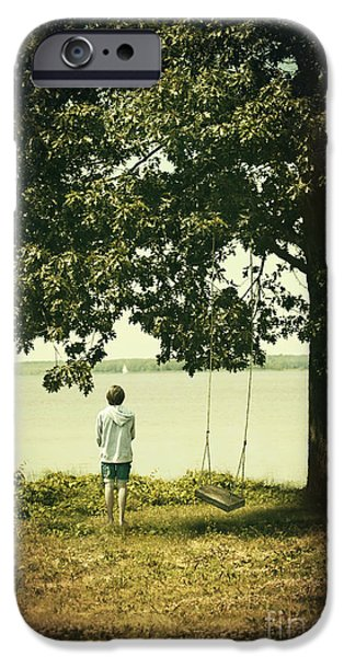 Young boy looking out at the water under a big tree iPhone Case by Sandra Cunningham