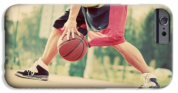 Dribbling iPhone Cases - Young man on basketball court dribbling with ball iPhone Case by Michal Bednarek